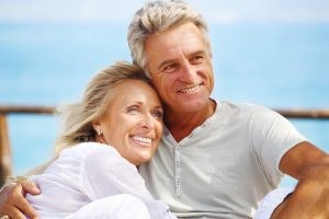 Couple who fixed their missing teeth with restorative dentistry in Lake Jackson, TX.