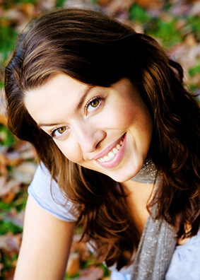 Smiling girl sought out a cosmetic dentist in Lake Jackson TX for her aesthetic dentistry needs.