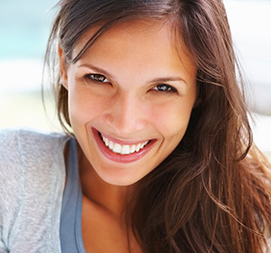 Smiling patient from Angleton after undergoing teeth whitening in Lake Jackson.